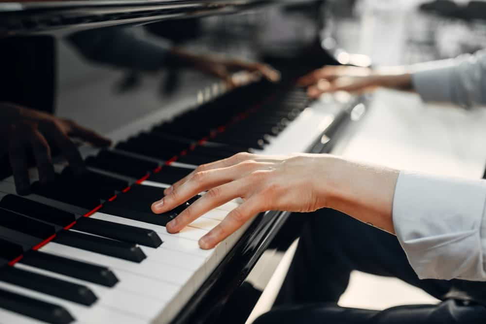 Close up on a Composer's hands playing the piano