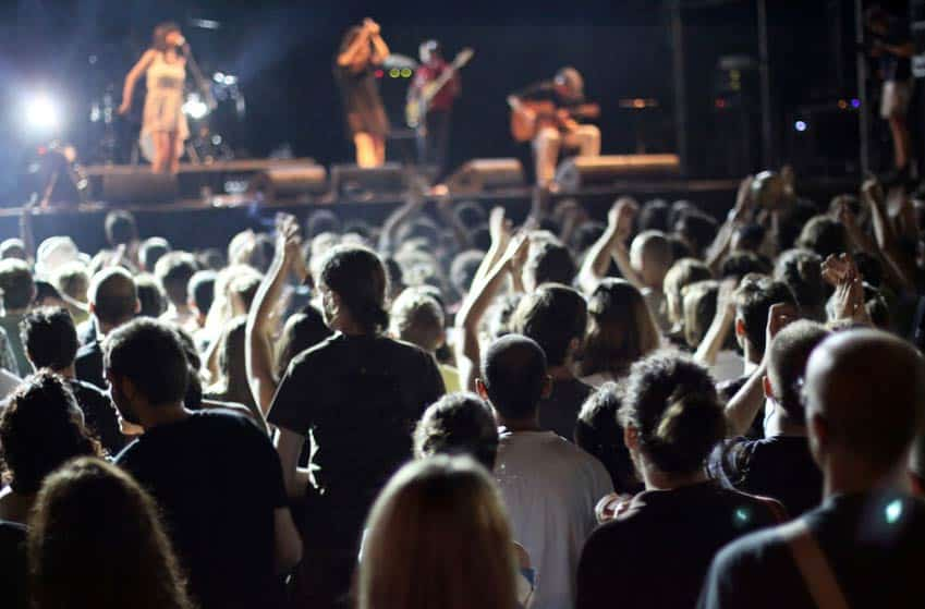 Band onstage with large crowd