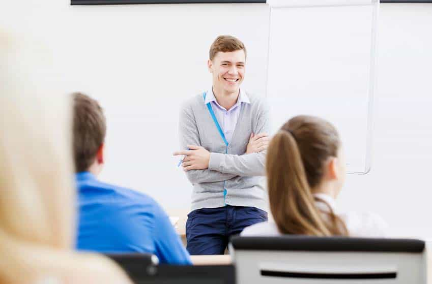 Musicologist at front of the classroom teaching college students