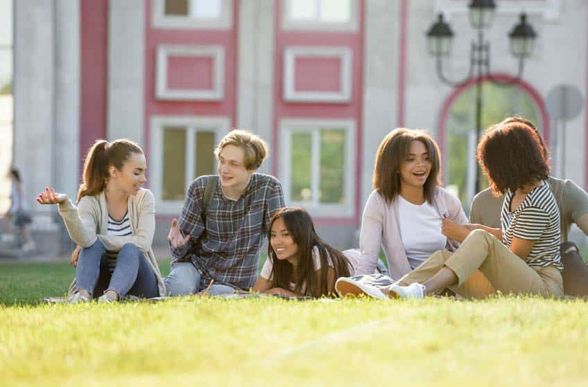 Music masters level students on campus lawn
