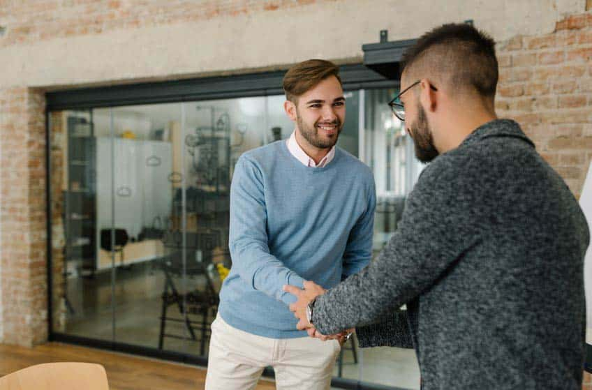 Music industry student shaking hands with potential employer at internship interview