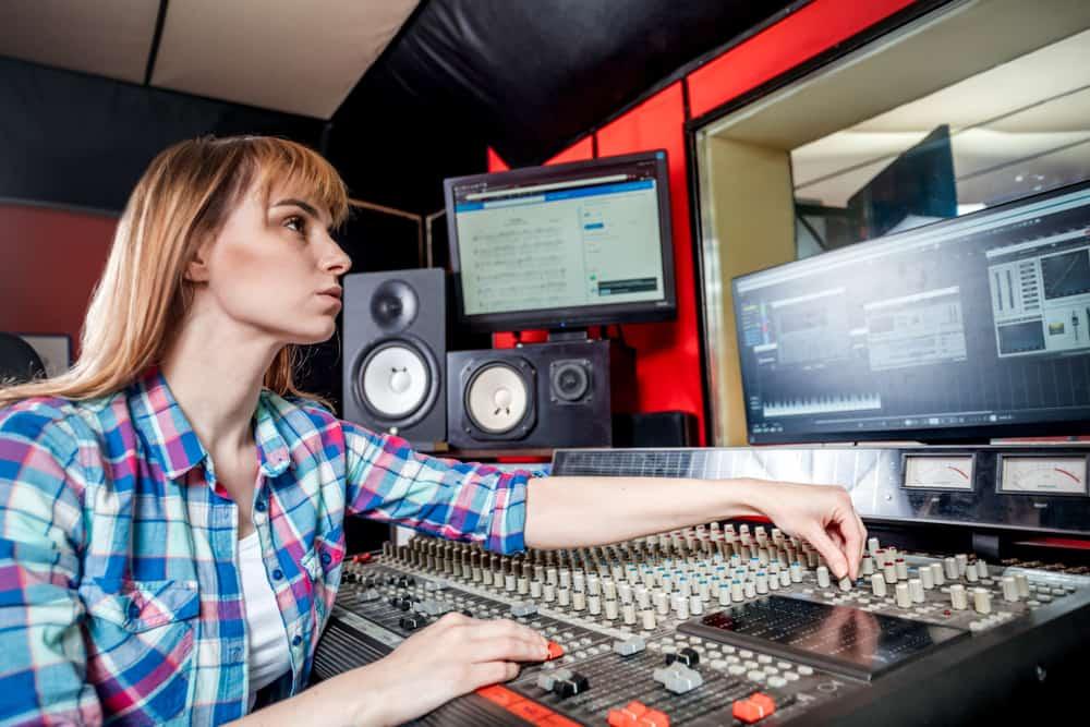 Audio engineer using DAW in recording studio